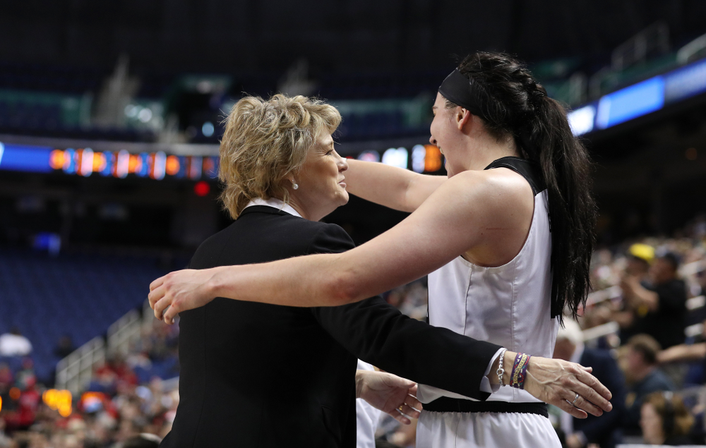 Iowa Hawkeyes head coach Lisa Bluder and forward Megan Gustafson (10) against the NC State Wolfpack in the regional semi-final of the 2019 NCAA Women's College Basketball Tournament Saturday, March 30, 2019 at Greensboro Coliseum in Greensboro, NC.(Brian Ray/hawkeyesports.com)