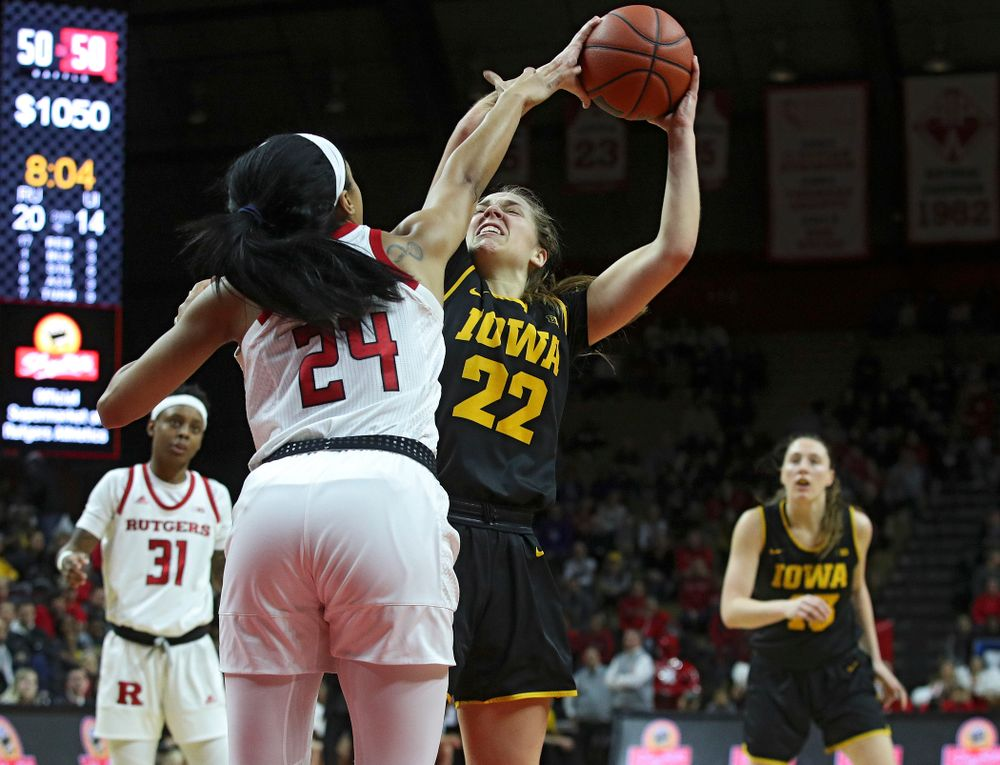 Iowa guard Kathleen Doyle (22) makes a basket during the second quarter of their game at the Rutgers Athletic Center in Piscataway, N.J. on Sunday, March 1, 2020. (Stephen Mally/hawkeyesports.com)