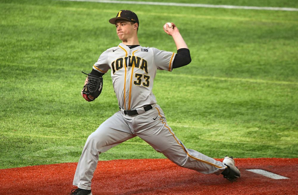 Iowa Hawkeyes pitcher Jack Dreyer (33) delivers to the plate during the first inning of their CambriaCollegeClassic game at U.S. Bank Stadium in Minneapolis, Minn. on Friday, February 28, 2020. (Stephen Mally/hawkeyesports.com)
