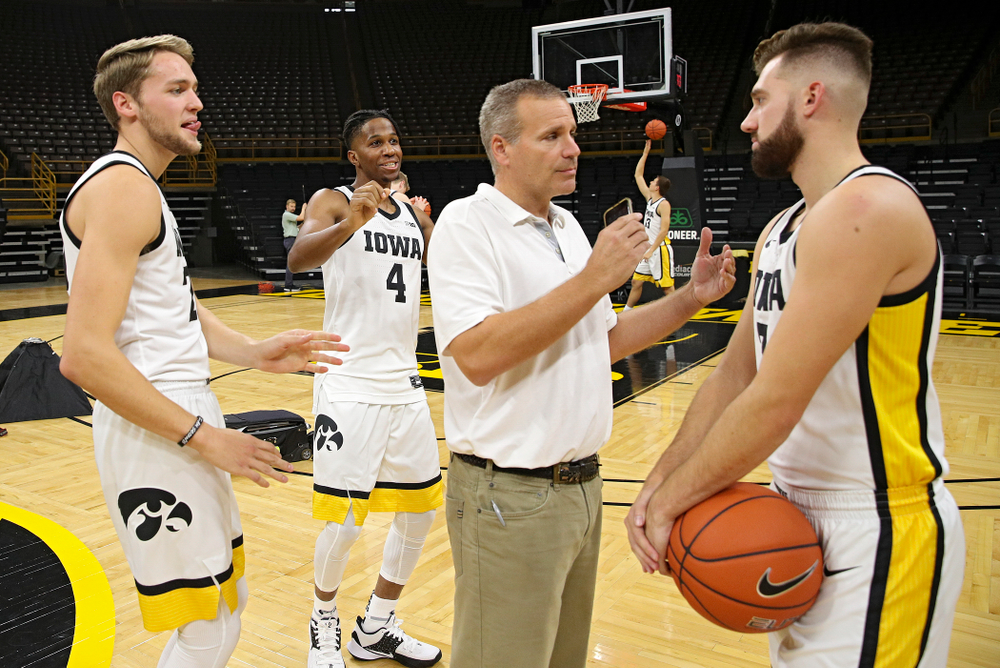 Iowa Hawkeyes forward Riley Till (20) and forward Bakari Evelyn (4) try to distract guard Jordan Bohannon (3) as he answers questions during Iowa Men's Basketball Media Day at Carver-Hawkeye Arena in Iowa City on Wednesday, Oct 9, 2019. (Stephen Mally/hawkeyesports.com)