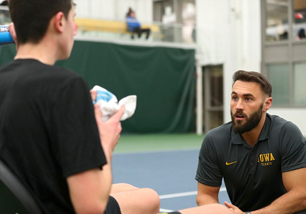 Iowa assistant coach Lloyd Bruce-Burgess (right) talks with Matt Clegg during his doubles match at the Hawkeye Tennis and Recreation Complex in Iowa City on Friday, February 14, 2020. (Stephen Mally/hawkeyesports.com)