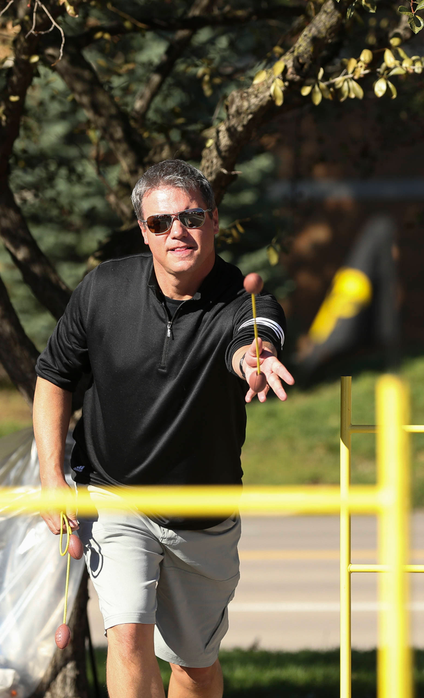 A fan plays a game of ladder toss before a game against Wisconsin on September 22, 2018.