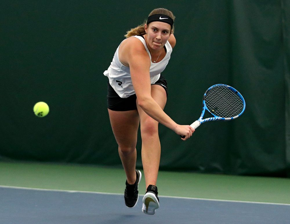 Iowa's Ashleigh Jacobs returns a shot during her singles match at the Hawkeye Tennis and Recreation Complex in Iowa City on Sunday, February 23, 2020. (Stephen Mally/hawkeyesports.com)