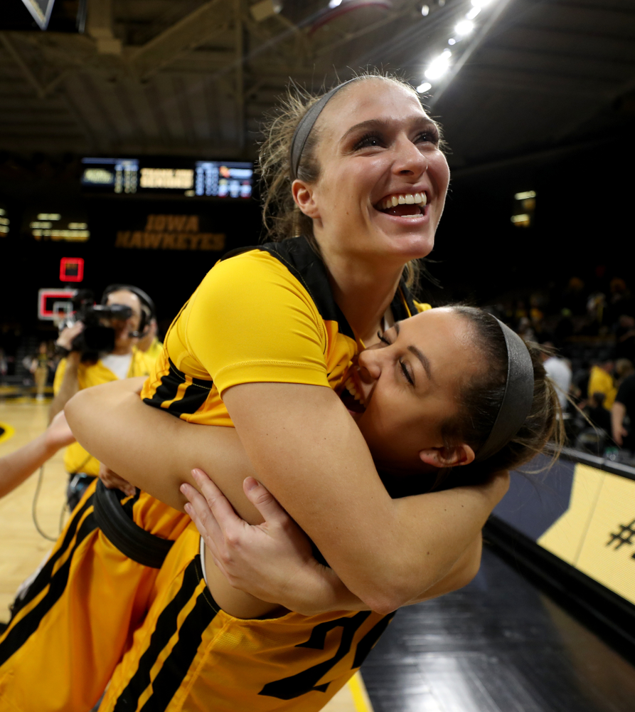 Iowa Hawkeyes guard Makenzie Meyer (3) hugs guard Gabbie Marshall (24) during senior day activities following their win over the Minnesota Golden Gophers Thursday, February 27, 2020 at Carver-Hawkeye Arena. (Brian Ray/hawkeyesports.com)