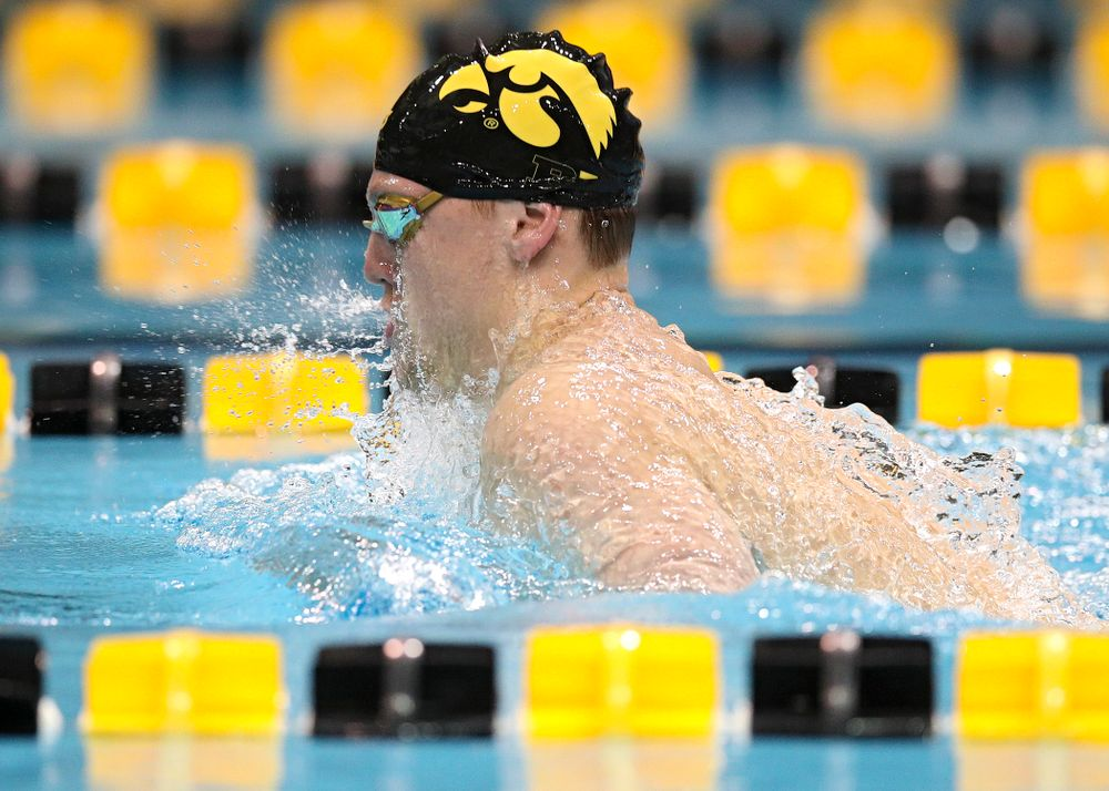 Iowa's Ryan Purdy swims the men's 100 yard breaststroke event during their meet at the Campus Recreation and Wellness Center in Iowa City on Friday, February 7, 2020. (Stephen Mally/hawkeyesports.com)