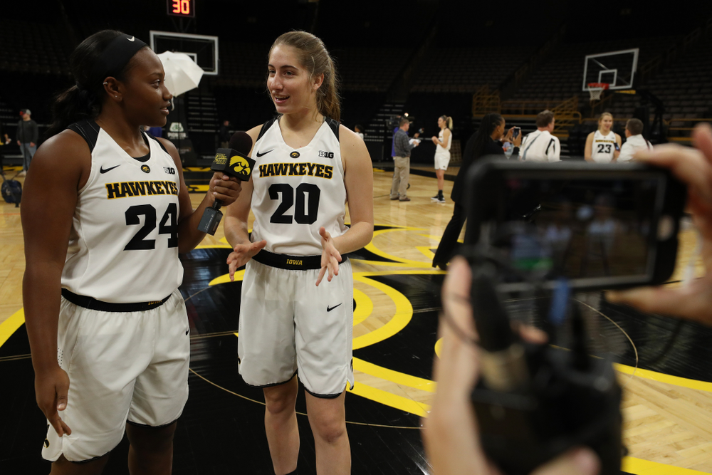 Iowa Hawkeyes guard Zion Sanders (24) and guard Kate Martin (20) during the team's annual media day Wednesday, October 31, 2018 at Carver-Hawkeye Arena. (Brian Ray/hawkeyesports.com)