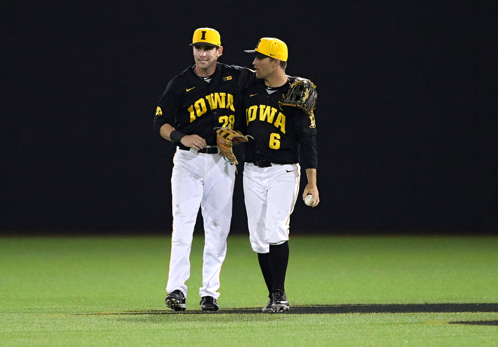 Iowa Hawkeyes left fielder Chris Whelan (28) puts his arm around center fielder Justin Jenkins (6) after the final out of the ninth inning of their game against Western Illinois at Duane Banks Field in Iowa City on Wednesday, May. 1, 2019. (Stephen Mally/hawkeyesports.com)