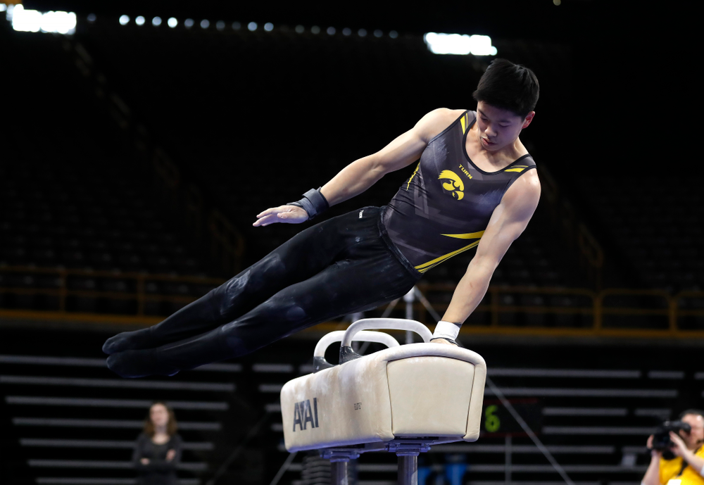 Bennet Huang competes on the pommel horse against Illinois