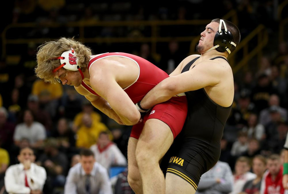 IowaÕs Tony Cassioppi wrestles WisconsinÕs Trent Hillger at heavyweight Sunday, December 1, 2019 at Carver-Hawkeye Arena. Cassioppi won the match 3-2. (Brian Ray/hawkeyesports.com)