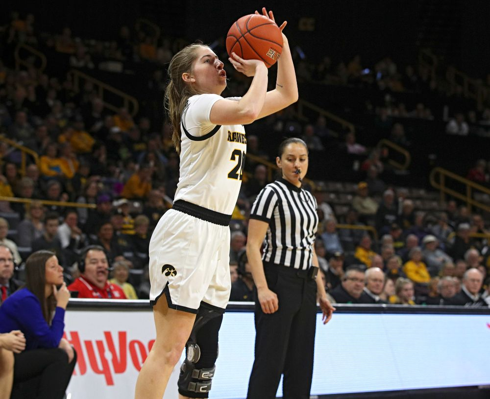 Iowa Hawkeyes guard Kate Martin (20) makes a 3-pointer during the second quarter of the game at Carver-Hawkeye Arena in Iowa City on Thursday, February 6, 2020. (Stephen Mally/hawkeyesports.com)