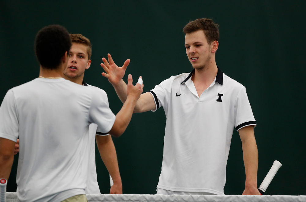 Will Davies and Piotr Smietana play a doubles match against Purdue Sunday, April 15, 2018 at the Hawkeye Tennis and Recreation Center. (Brian Ray/hawkeyesports.com)
