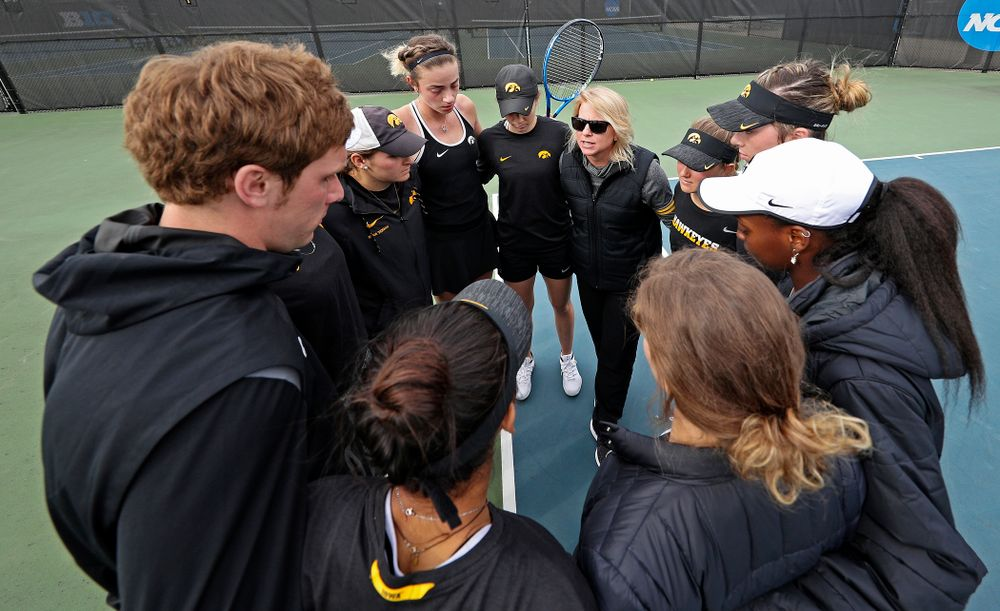 Iowa head coach Sasha Schmid talks with her team after their match against Rutgers at the Hawkeye Tennis and Recreation Complex in Iowa City on Friday, Apr. 5, 2019. (Stephen Mally/hawkeyesports.com)