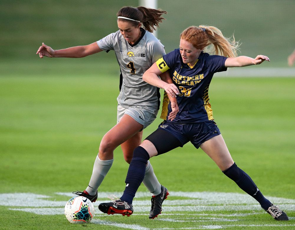 Iowa forward Kaleigh Haus (4) tries to get around a defender during the first half of their match at the Iowa Soccer Complex in Iowa City on Friday, Sep 13, 2019. (Stephen Mally/hawkeyesports.com)
