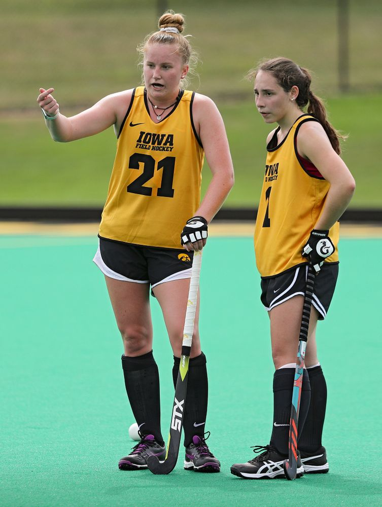Iowa's Makenna Maguire (21) talks with Amy Gaiero (1) as they work on a drill during practice at Grant Field in Iowa City on Thursday, Aug 15, 2019. (Stephen Mally/hawkeyesports.com)