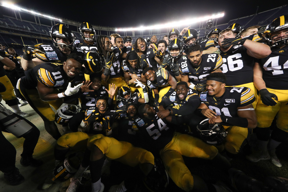 The Iowa Hawkeyes celebrate their win against USC in the Holiday Bowl Friday, December 27, 2019 at San Diego Community Credit Union Stadium.  (Brian Ray/hawkeyesports.com)