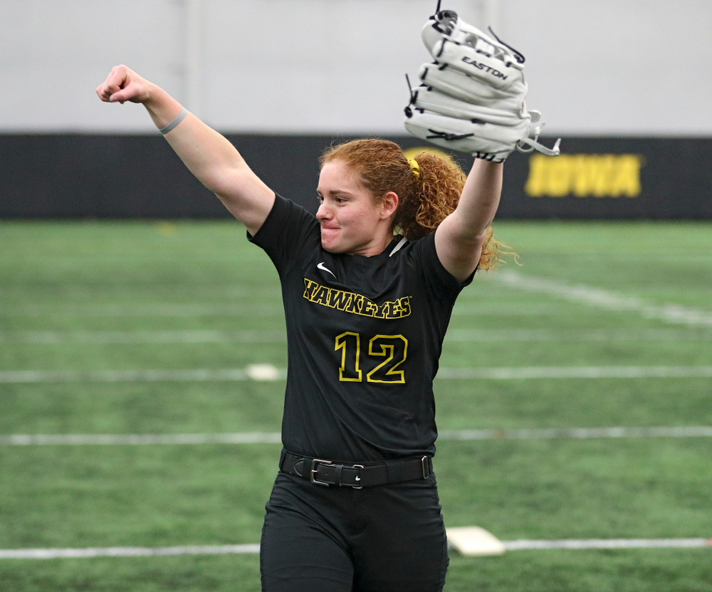 Iowa catcher/infielder Kate Claypool (12) pumps her fist after hitting a target with a ball during Iowa Softball Media Day at the Hawkeye Tennis and Recreation Complex in Iowa City on Thursday, January 30, 2020. (Stephen Mally/hawkeyesports.com)