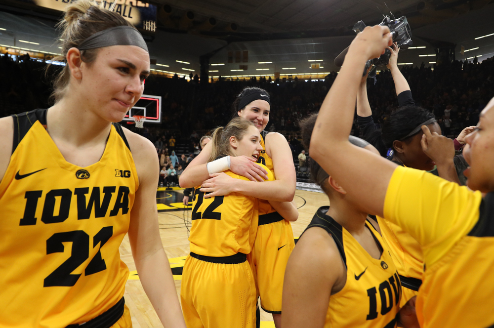Iowa Hawkeyes forward Megan Gustafson (10) and guard Kathleen Doyle (22) during senior day ceremonies following their game against the Northwestern Wildcats Sunday, March 3, 2019 at Carver-Hawkeye Arena. (Brian Ray/hawkeyesports.com)