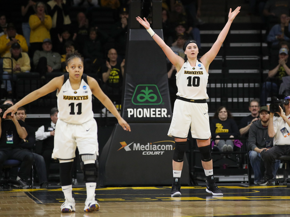Iowa Hawkeyes center Megan Gustafson (10) pumps up the crowd as guard Tania Davis (11) defends during the second quarter of their second round game in the 2019 NCAA Women's Basketball Tournament at Carver Hawkeye Arena in Iowa City on Sunday, Mar. 24, 2019. (Stephen Mally for hawkeyesports.com)