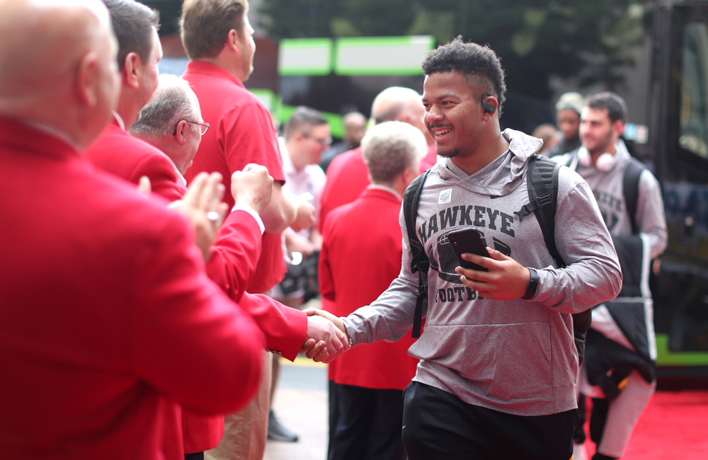 Iowa Hawkeyes running back Ivory Kelly-Martin (21) shakes hands with the ÒRed CoatsÓ after arriving in San Diego, CA Saturday, December 21, 2019 for the Holiday Bowl. (Brian Ray/hawkeyesports.com)