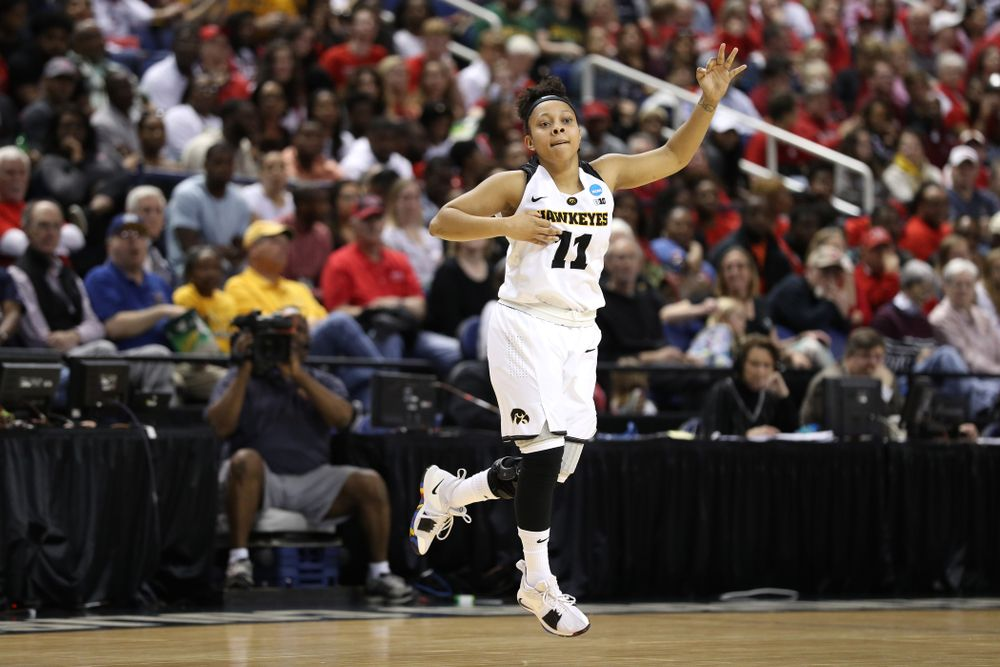 Iowa Hawkeyes guard Tania Davis (11) celebrates a three point basket against the NC State Wolfpack in the regional semi-final of the 2019 NCAA Women's College Basketball Tournament Saturday, March 30, 2019 at Greensboro Coliseum in Greensboro, NC.(Brian Ray/hawkeyesports.com)