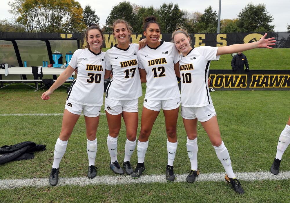 Iowa Hawkeyes forward Devin Burns (30), defender Hannah Drkulec (17), forward Olivia Fiegel (12), and midfielder/defender Natalie Winters (10) before their game against the Maryland Terrapins Sunday, October 13, 2019 on senior day. (Brian Ray/hawkeyesports.com)