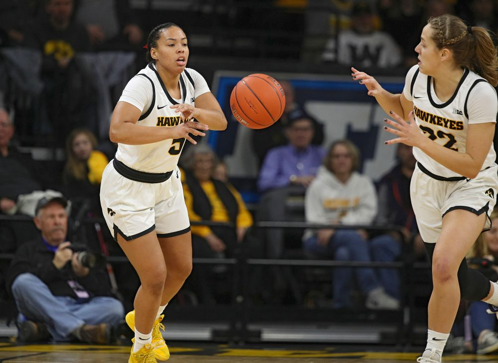 Iowa Hawkeyes guard Alexis Sevillian (5) passes the ball to guard Kathleen Doyle (22) during the first quarter of their game at Carver-Hawkeye Arena in Iowa City on Sunday, January 26, 2020. (Stephen Mally/hawkeyesports.com)