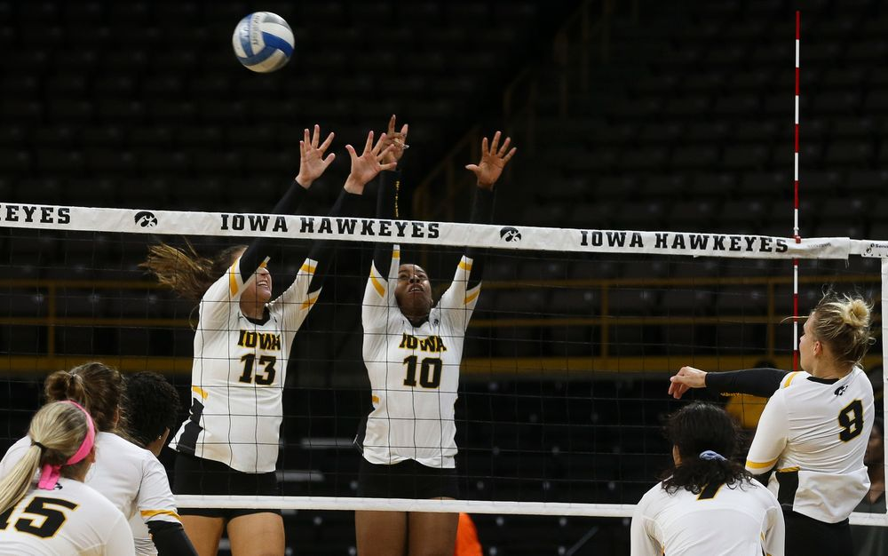 Iowa Hawkeyes middle blocker Sara Wing (13), Iowa Hawkeyes outside hitter Griere Hughes (10)
