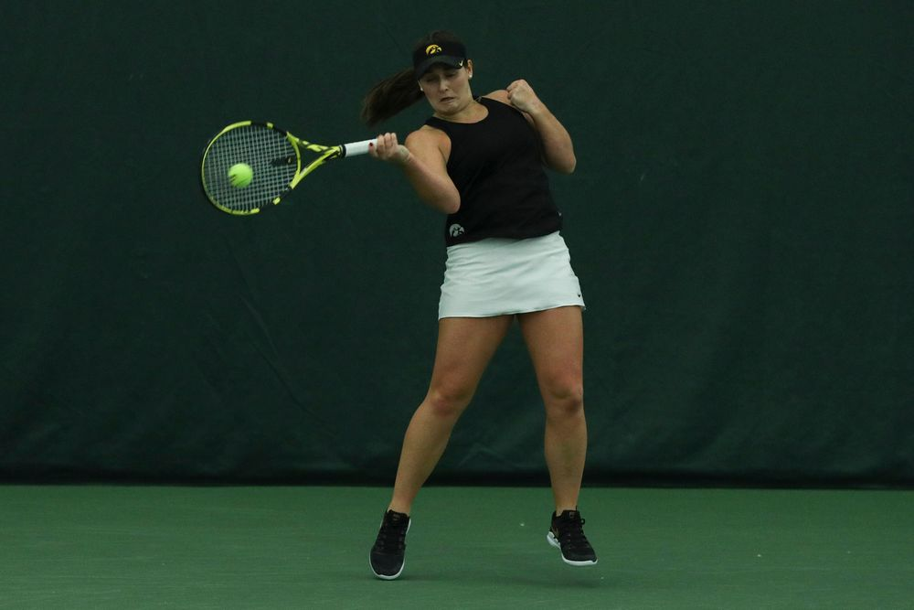 Iowa's Danielle Bauers returns a hit during the Iowa women's tennis meet vs DePaul  on Friday, February 21, 2020 at the Hawkeye Tennis and Recreation Complex. (Lily Smith/hawkeyesports.com)