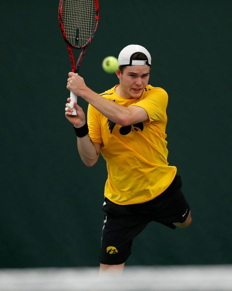 Jonas Larsen against the Illinois Fighting Illini Saturday, March 31, 2018 at Hawkeye Tennis and Recreation Center. (Brian Ray/hawkeyesports.com)