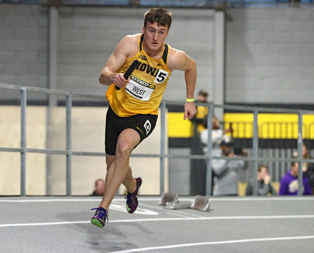 Iowa's Austin West runs the men's 1600 meter relay event during the Hawkeye Invitational at the Recreation Building in Iowa City on Saturday, January 11, 2020. (Stephen Mally/hawkeyesports.com)