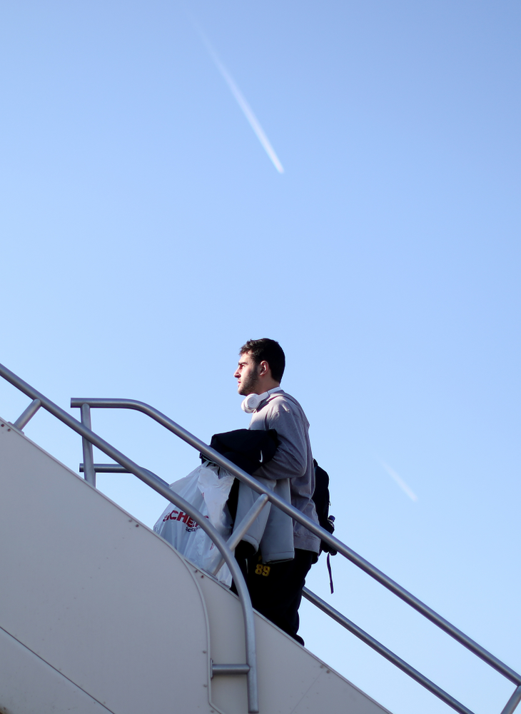 Iowa Hawkeyes wide receiver Nico Ragaini (89) boards the team plane at the Eastern Iowa Airport Saturday, December 21, 2019 on the way to San Diego, CA for the Holiday Bowl. (Brian Ray/hawkeyesports.com)