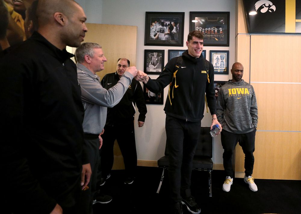 Iowa Hawkeyes forward Luka Garza (55) fist bumps assistant coach Kirk Speraw after finding out he has been named the Big Ten Player of the Year Monday, March 9, 2020 at Carver-Hawkeye Arena. (Brian Ray/hawkeyesports.com)