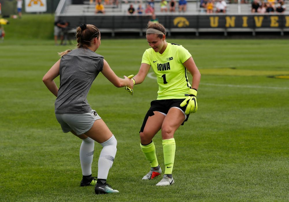 Iowa Hawkeyes Claire Graves (1) and  Karson Rauch (9) against Indiana State Sunday, August 26, 2018 at the Iowa Soccer Complex. (Brian Ray/hawkeyesports.com)