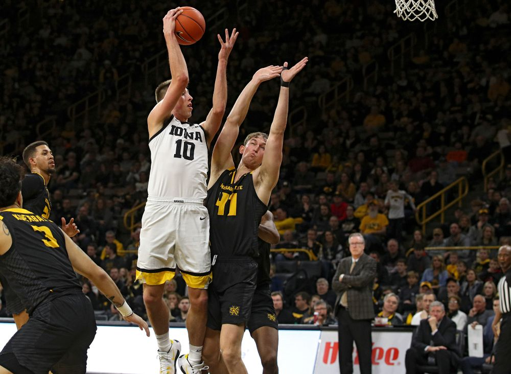 Iowa Hawkeyes guard Joe Wieskamp (10) passes the ball to center Luka Garza (not pictured) who dunks it during the second half of their their game at Carver-Hawkeye Arena in Iowa City on Sunday, December 29, 2019. (Stephen Mally/hawkeyesports.com)