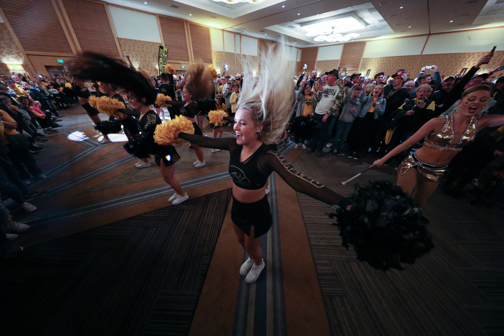 The Hawkeye Marching Band and the Iowa Spirit Squads perform during the Holiday Bowl Hawkeye Huddle Thursday, December 26, 2019 at the Hilton in downtown San Diego. (Brian Ray/hawkeyesports.com)