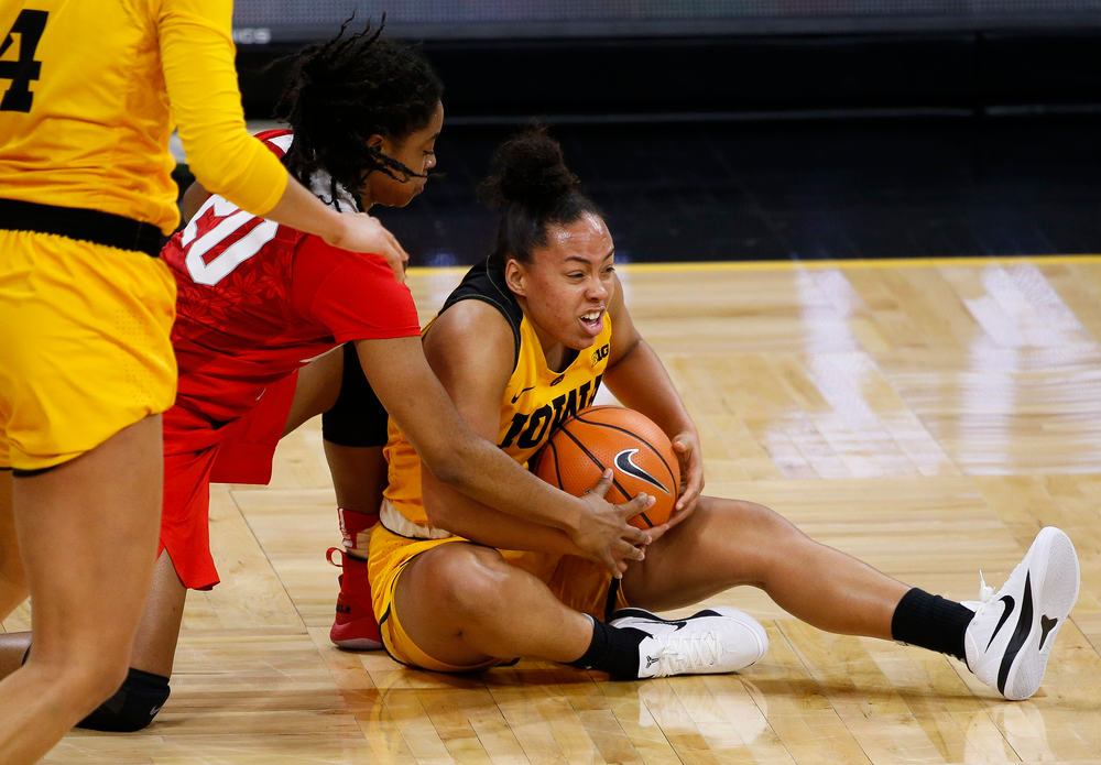Iowa Hawkeyes guard Alexis Sevillian (5) corralls a loose ball during a game against the Ohio State Buckeyes at Carver-Hawkeye Arena on January 25, 2018. (Tork Mason/hawkeyesports.com)