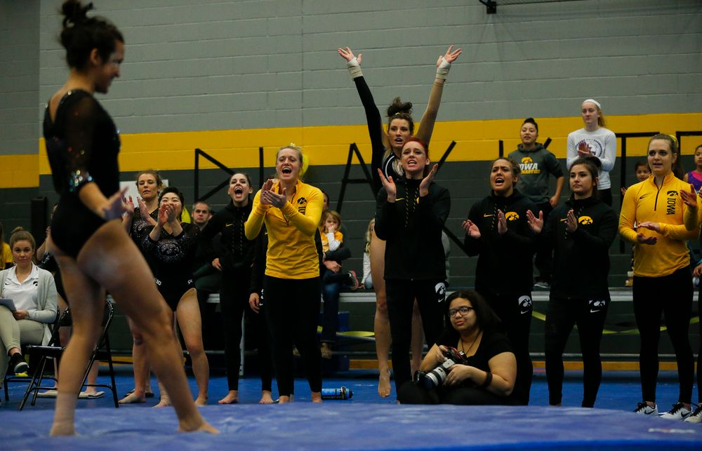 Iowa Hawkeyes gymnasts react during Gina Leal's floor routine during the Black and Gold Intrasquad meet at the Field House on 12/2/17. (Tork Mason/hawkeyesports.com)