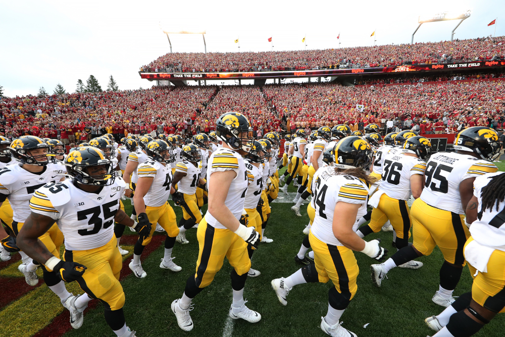 The Iowa Hawkeyes swarm onto the field for their game against the Iowa State Cyclones Saturday, September 14, 2019 at Jack Trice Stadium in Ames, Iowa. (Brian Ray/hawkeyesports.com)