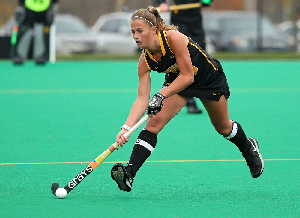 Iowa's Sophie Sunderland (20) moves with the ball during the third quarter of their game at Grant Field in Iowa City on Saturday, Oct 26, 2019. (Stephen Mally/hawkeyesports.com)