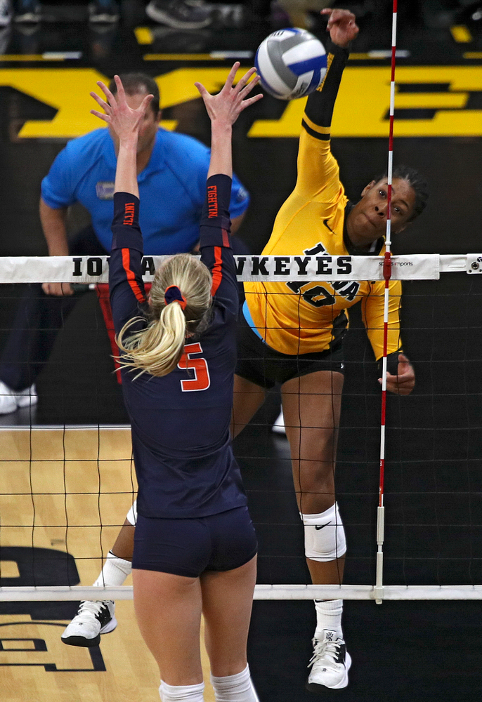 Iowa's Griere Hughes (10) gets a kill during the first set of their match against Illinois at Carver-Hawkeye Arena in Iowa City on Wednesday, Nov 6, 2019. (Stephen Mally/hawkeyesports.com)