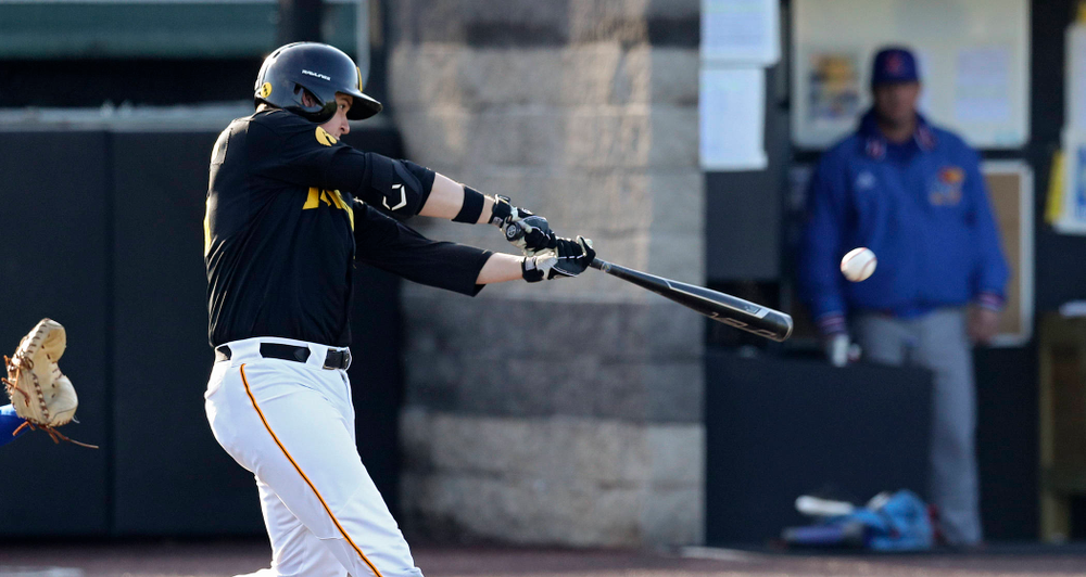 Iowa first baseman Peyton Williams (45) hits a double during the third inning of their college baseball game at Duane Banks Field in Iowa City on Tuesday, March 10, 2020. (Stephen Mally/hawkeyesports.com)