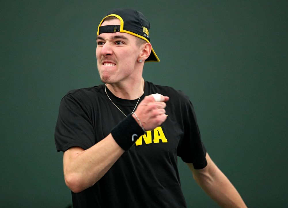 Iowa's Nikita Snezhko celebrates a point during his doubles match at the Hawkeye Tennis and Recreation Complex in Iowa City on Friday, February 14, 2020. (Stephen Mally/hawkeyesports.com)