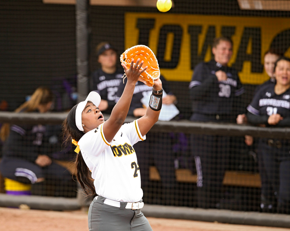 Iowa Hawkeyes DoniRae Mayhew (24) pulls in a pop up for an out during the second inning of their Big Ten Conference softball game at Pearl Field in Iowa City on Friday, Mar. 29, 2019. (Stephen Mally/hawkeyesports.com)