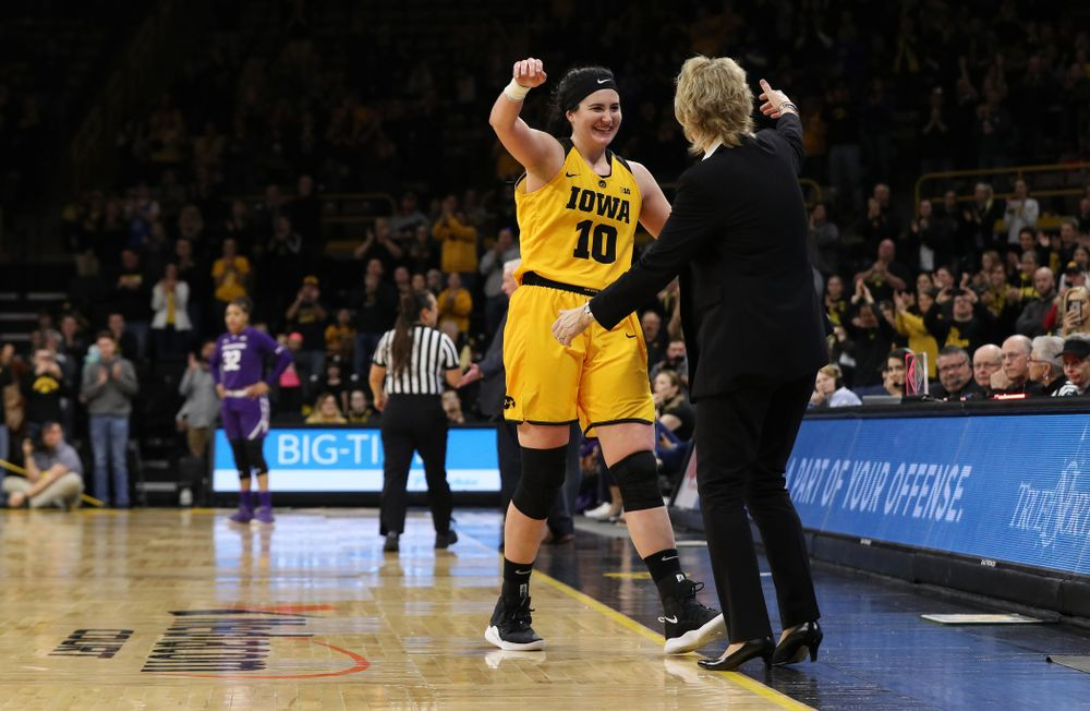 Iowa Hawkeyes forward Megan Gustafson (10) hugs head coach Lisa Bluder as she lives the court for the final time against the Northwestern Wildcats Sunday, March 3, 2019 at Carver-Hawkeye Arena. (Brian Ray/hawkeyesports.com)