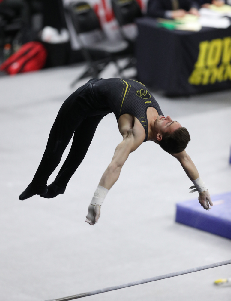 Iowa's Mitch Mandozzi competes on the high bar against Oklahoma Saturday, February 9, 2019 at Carver-Hawkeye Arena. (Brian Ray/hawkeyesports.com)