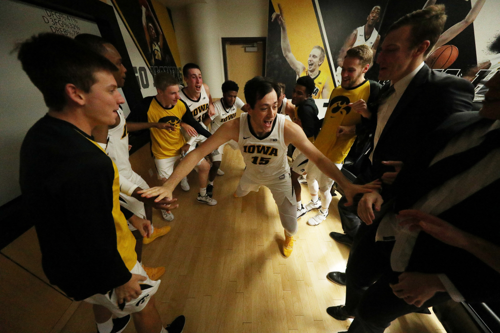 Iowa Hawkeyes forward Ryan Kriener (15) celebrates their victory against the Pitt Panthers Tuesday, November 27, 2018 at Carver-Hawkeye Arena. (Brian Ray/hawkeyesports.com)