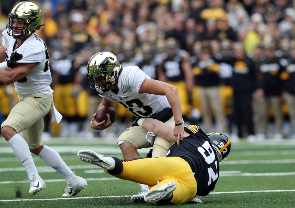 Iowa Hawkeyes defensive lineman John Waggoner (92) sacks Purdue Boilermakers quarterback Jack Plummer Saturday, October 19, 2019 at Kinnick Stadium. (Brian Ray/hawkeyesports.com)