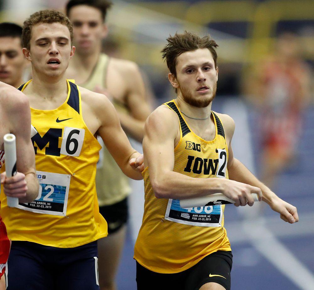 Tysen VanDraska gets a nudge form a Michigan runner