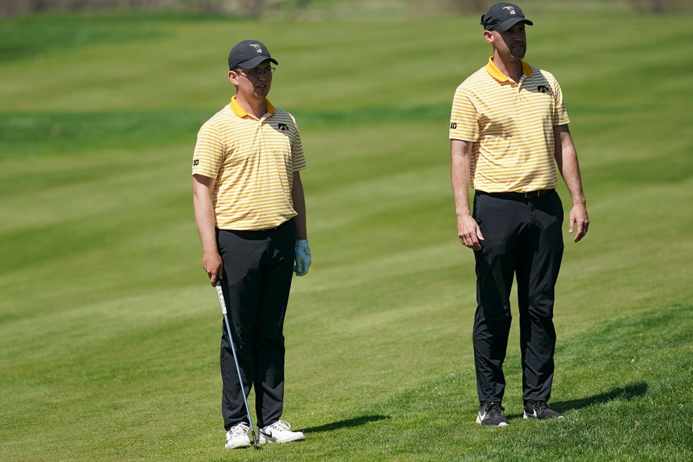 Iowa Matthew Walker (from left) talks with head coach Tyler Stith during the third round of the Hawkeye Invitational at Finkbine Golf Course in Iowa City on Sunday, Apr. 21, 2019. (Stephen Mally/hawkeyesports.com)