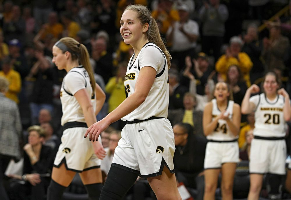 Iowa Hawkeyes guard Kathleen Doyle (22) smiles after making a basket while being fouled during the fourth quarter of their game at Carver-Hawkeye Arena in Iowa City on Sunday, January 26, 2020. (Stephen Mally/hawkeyesports.com)